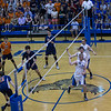 St. Charles North's Kevin Beach (10) Jake Hamilton (12) and Pat Misiewicz (3) celebrate after blocking a kill attempt by Oak Park-River Forest's Elliot Mertz (4) during their state quarterfinal game at Hoffman Estates High School in Hoffman Estates, IL on Friday, May 31, 2013 (Sean King for The Kane County Chronicle)