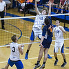 St. Charles North's Jack Bujko (14) goes for a kill against Oak Park-River Forest's Elliot Mertz (4) during their state quarterfinal game at Hoffman Estates High School in Hoffman Estates, IL on Friday, May 31, 2013 (Sean King for The Kane County Chronicle)