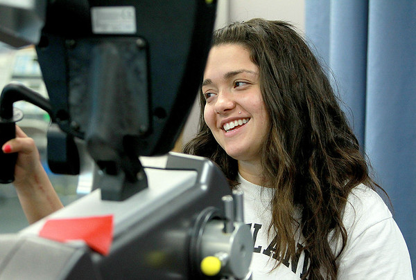Kaneland High School senior Samantha Garcia works on a stationary bicycle during a physical therapy session at Rush Copley Medical Center. Garcia, of Montgomery, is recovering from severe injuries sustained in a car crash last July.