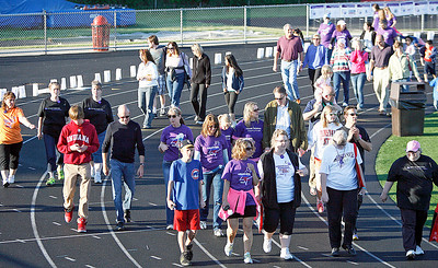 After the survivor lap supports and caregivers make the ceremonial walk.The annual Relay For Life for the Barrington area brings survivors, care-takers and volutneers to the athletic track at Barrington High School to celebrate life, honor the memory of those gone and help raise funds for research and a cure.. | Joe Cyganowski-For Barrington Life