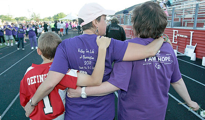 A feeling of solidarity and support as survivors circle the track. The annual Relay For Life for the Barrington area brings survivors, care-takers and volutneers to the athletic track at Barrington High School to celebrate life, honor the memory of those gone and help raise funds for research and a cure.. | Joe Cyganowski-For Barrington Life
