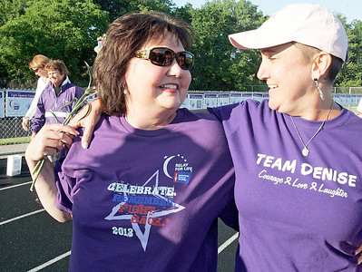 Wendy Goodman (left) a 20 year survivor and recent lung transplant recipient shares a moment on the track with friend Denise Oetinger during the  annual Relay For Life for the Barrington area brings survivors, care-takers and volutneers to the athletic track at Barrington High School to celebrate life, honor the memory of those gone and help raise funds for research and a cure.. | Joe Cyganowski-For Barrington Life