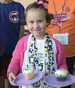 Piper Novak, 5, DeerPark delivers cupcakes at the survivors dinner. The annual Relay For Life for the Barrington area brings survivors, care-takers and volutneers to the athletic track at Barrington High School to celebrate life, honor the memory of those gone and help raise funds for research and a cure.. | Joe Cyganowski-For Barrington Life