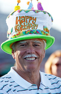 Bob Nemec , Barrington, a 14 year survivor proudly displays his birthday hat and his ability to celebrate another. The annual Relay For Life for the Barrington area brings survivors, care-takers and volutneers to the athletic track at Barrington High School to celebrate life, honor the memory of those gone and help raise funds for research and a cure.. | Joe Cyganowski-For Barrington Life