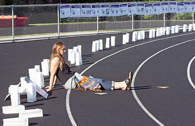 Mia Calamari takes a break from setting up luminaria. The annual Relay For Life for the Barrington area brings survivors, care-takers and volutneers to the athletic track at Barrington High School to celebrate life, honor the memory of those gone and help raise funds for research and a cure.. | Joe Cyganowski-For Barrington Life