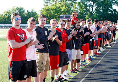 The Barrington High School football team forms an honor line to salute the survivors. The annual Relay For Life for the Barrington area brings survivors, care-takers and volutneers to the athletic track at Barrington High School to celebrate life, honor the memory of those gone and help raise funds for research and a cure.. | Joe Cyganowski-For Barrington Life