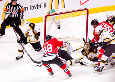 Kyle Grillot - kgrillot@shawmedia.com Chicago's Patrick Kane (88) moves the puck towards the net under the defense of Boston's Andrew Ference (21) during the first period of game 2 of the 2013 Stanley Cup Finals against Boston at the United Center in Chicago Wednesday, June 15, 2013.