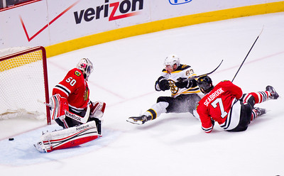 Kyle Grillot - kgrillot@shawmedia.com Boston's Brad Marchand watches as his shot slides past the goal during Game 2 of the 2013 Stanley Cup Finals against Boston at the United Center in Chicago Wednesday, June 15, 2013.