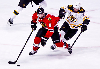 Kyle Grillot - kgrillot@shawmedia.com Boston's Rich Peverley pulls on Chicago's Nick Leddy while he controls the puck during Game 2 of the 2013 Stanley Cup Finals against Boston at the United Center in Chicago Wednesday, June 15, 2013.