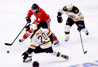 Kyle Grillot - kgrillot@shawmedia.com Chicago's Nick Leddy fights to control the puck during the second period of Game 2 of the 2013 Stanley Cup Finals against Boston at the United Center in Chicago Wednesday, June 15, 2013.