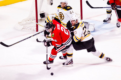 Kyle Grillot - kgrillot@shawmedia.com Chicago's Duncan Keith fights for control of the puck during the first period of game 2 of the 2013 Stanley Cup Finals against Boston at the United Center in Chicago Wednesday, June 15, 2013.