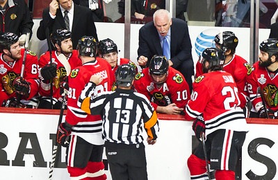 Kyle Grillot - kgrillot@shawmedia.com Chicago's head coach Joel Quenneville talks with a refferee during the first period of game 2 of the 2013 Stanley Cup Finals against Boston at the United Center in Chicago Wednesday, June 15, 2013.