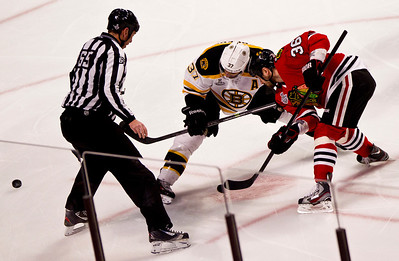 Kyle Grillot - kgrillot@shawmedia.com Chicago's Dave Bolland (36) and Boston's Patrice Bergeron fight for control as the puck is dropped duing the first period of game 2 of the 2013 Stanley Cup Finals against Boston at the United Center in Chicago Wednesday, June 15, 2013.
