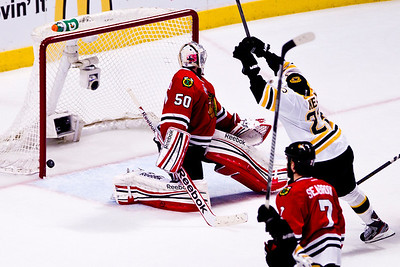 Kyle Grillot - kgrillot@shawmedia.com Boston's Chris Kelly (23) celebrates as Daniel Paille's (not pictured) winning point goes into the net during the first overtime period of the 2013 Stanley Cup Finals against Boston at the United Center in Chicago Wednesday, June 15, 2013.