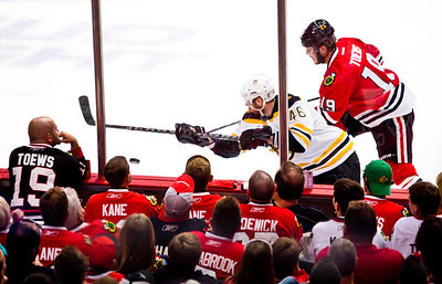 Kyle Grillot - kgrillot@shawmedia.com Chicago's Jonathan Toews (19) and Boston's David Krejci (46) fight for control of the puck during the second period  of game 2 of the 2013 Stanley Cup Finals against Boston at the United Center in Chicago Wednesday, June 15, 2013.