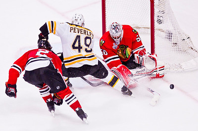 Kyle Grillot - kgrillot@shawmedia.com Chicago's Corey Crawford (50) blocks Boston's Rich Peverley's (49) shot during Game 2 of the 2013 Stanley Cup Finals against Boston at the United Center in Chicago Wednesday, June 15, 2013.