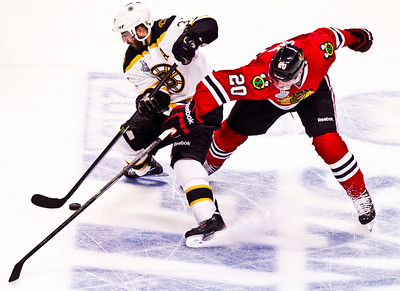 Kyle Grillot - kgrillot@shawmedia.com Chicago's Brandon Saad (20) and Bostons Patrice Bergeron fight for the puck during the third period of game 2 of the 2013 Stanley Cup Finals against Boston at the United Center in Chicago Wednesday, June 15, 2013.