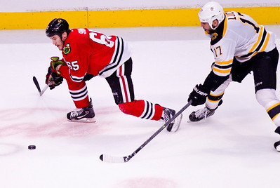 Kyle Grillot - kgrillot@shawmedia.com Chicago's Andrew Shaw fights to control the puck during the second period of Game 2 of the 2013 Stanley Cup Finals against Boston at the United Center in Chicago Wednesday, June 15, 2013.