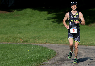 Matthew Ancona was the first person to finish all three legs of the Lake in the Hills Triathlon on Sunday.  Brett Moist /For the Northwest Herald