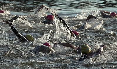 Competitors start the mile long swim portion of the Lake in the Hills Triathlon. Brett Moist / For the Northwest Herald