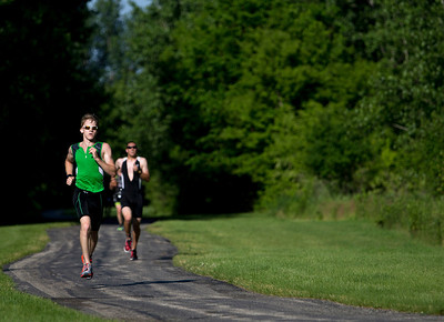 Kyle Bostedt leads a group of runners during the Lake in the Hills Triathlon. Brett Moist / For the Northwest Herald