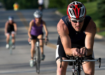 Todd Sander leads a group of bikers during the Lake in the Hills Triathlon on Sunday. Brett Moist / For the Northwest Herald