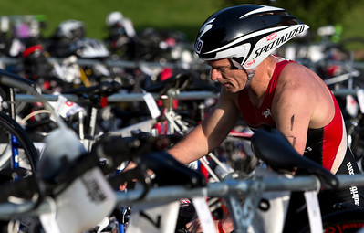 Steve Bland gets his bike ready for the 2nd leg of the Lake in the Hills Triathlon. Brett Moist / For the Northwest Herald