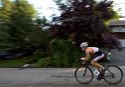 Bradley Lindgren flies down Indian Trail Road during the 2nd leg of the Lake in the Hills Triathlon. Brett Moist / For the Northwest Herald