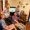 Eric Bettag and his wife, Joan (far right) talk with their kids Ben, 10, Elizabeth, 18, and Sarah, 16, in the family room of their Maple Park home. Alice, 15, and Isabel, 13, are not pictured. Eric was injured in a car accident in 2007.