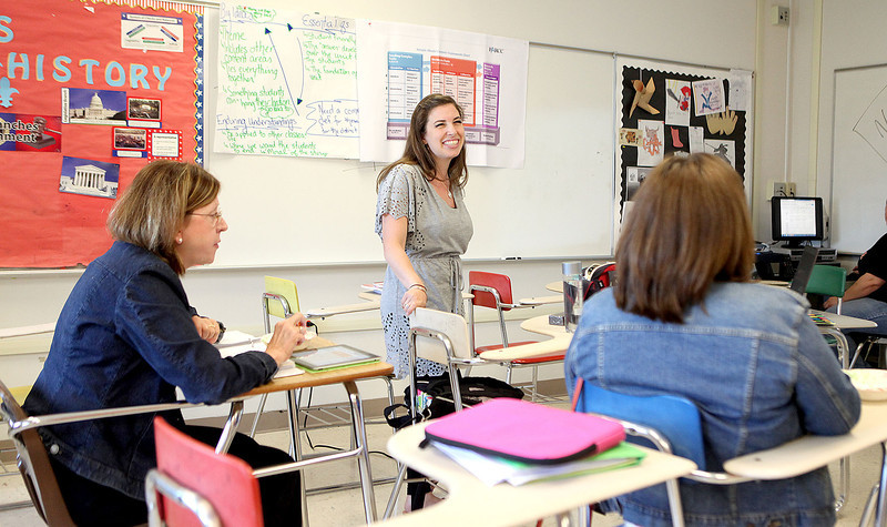 Haines Middle School teacher Trisha Abbinante (center) discusses the St. Charles School District 303 eighth grade curriculum with Thompson Middle School teachers Susan Izzo (left) and Jody Falotio (right) at St. Charles East High School Tuesday.