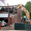 Workers demolish the Coultrap facility in Geneva Tuesday afternoon.