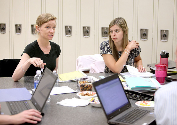 Norton Creek teacher Kristin Berry (left) and Fox Ridge teacher Laurelie Schaeffer (right) discuss the St. Charles School District 303 second grade curriculum at St. Charles East High School Tuesday.