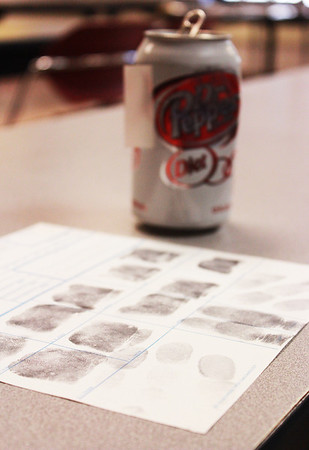 A soda can with fingerprints was used as evidence during the St. Charles Police Department Youth Academy mock crime scene at St. Charles North High School Tuesday. The mock crime scene was staged as a burglary at St. Charles North High School by the St. Charles Police Department.
