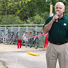 Kane County Forest Preserve President John J. Hoscheit addresses the crowd during a ribbon cutting ceremony for<br /> the pedestrian/bicycle crossing of the Red Gate Bridge in St. Charles, IL on Saturday, June 15, 2013 (Sean King for Shaw Media)