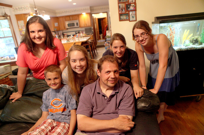 Eric Bettag and his five children (clockwise from bottom left) Ben, 10, Alice, 15, Elizabeth, 18, Isabel, 13, and Sarah, 16. Eric was injured in a car accident in 2007.