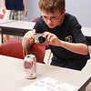 Dillon Quinn, 14, of St. Charles photographs a soda can for evidence during the St. Charles Police Department Youth Academy mock crime scene at St. Charles North High School Tuesday. The mock crime scene was staged as a burglary at St. Charles North High School by the St. Charles Police Department.