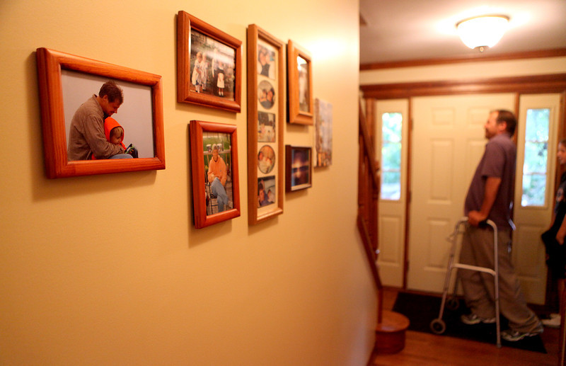 Eric Bettag walks through the hall of his  Maple Park home. Eric was injured in a car accident in 2007. He and his wife, Joan, have five children; Elizabeth, 18, Sarah, 16, Alice, 15, Isabel, 13, and Ben, 10.