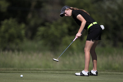 Kyle Grillot - kgrillot@shawmedia.com   Crystal Lake South's Bailey Bostler putts the ball at hole four during the McHenry County Junior Golf Association's Redtail Open Tournament Wednesday, June 19, 2013 at the Redtail Golf Course in Lakewood. Bostler tied in second place with Gillian Young with a score of 43.