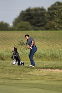 Kyle Grillot - kgrillot@shawmedia.com   Aman Roy of Hawthorne Woods chips the ball at hole four during the McHenry County Junior Golf Association's Redtail Open Tournament Wednesday, June 19, 2013 at the Redtail Golf Course in Lakewood.