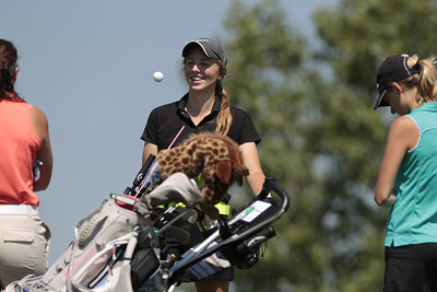 Kyle Grillot - kgrillot@shawmedia.com   Crystal Lake South's Bailey Bostler plays with her ball while talking with her group at hole two during the McHenry County Junior Golf Association's Redtail Open Tournament Wednesday, June 19, 2013 at the Redtail Golf Course in Lakewood. Bostler tied in second place with Gillian Young with a score of 43.