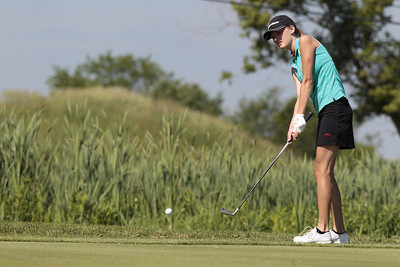 Kyle Grillot - kgrillot@shawmedia.com   Huntley's Zoe Dowell chips the ball at hole four during the McHenry County Junior Golf Association's Redtail Open Tournament Wednesday, June 19, 2013 at the Redtail Golf Course in Lakewood. Dowell came in 3rd with a score of 46.