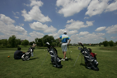Kyle Grillot - kgrillot@shawmedia.com   Boys wait for the previous group to advance before teeing off during the McHenry County Junior Golf Association's Redtail Open Tournament Wednesday, June 19, 2013 at the Redtail Golf Course in Lakewood.