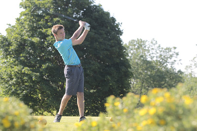 Kyle Grillot - kgrillot@shawmedia.com   Huntley's Glenn Miller tees off at hole one during during the McHenry County Junior Golf Association's Redtail Open Tournament Wednesday, June 19, 2013 at the Redtail Golf Course in Lakewood.