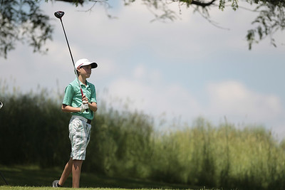 Kyle Grillot - kgrillot@shawmedia.com   Ethan Farnam of Crystal Lake watches his ball after teeing off hole 18 during the McHenry County Junior Golf Association's Redtail Open Tournament Wednesday, June 19, 2013 at the Redtail Golf Course in Lakewood. Farnam came in second place with a score of 76.
