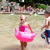 Three-year-old Teagan Lindsay gets splashed by her cousin, T.J. Nystrom, 5, while playing at Harold Hall Quarry Beach in Batavia.