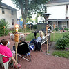 Friends and neighbors of St. Charles resident Tom Campana watch the Chicago Blackhawks play the Boston Bruins in Game 4 of the Stanley Cup Finals Wednesday night from a large screen that hangs from his porch.