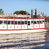 Members of the St. Charles Chamber of Commerce ride aboard the Fox River Queen during the 22nd annual Paddleboat Mixer hosted by Wednesday evening.