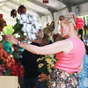 Diane Ringel of Cary sorts through flowers at The Little Traveler during the Swedish Days Festival in Geneva Tuesday.