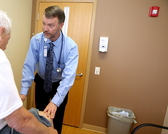 Dr. Jon Christofersen works with a patient at the Dreyer Clinic at Fox Valley Villages in Aurora.