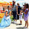 Nora (left middle) and Lila (right) Storaasi, ages 3 and 7, from Geneva stop to meet Cinderella on their way to camp during Geneva's annual Swedish Days festival on Wednesday.  The festival covered most of the downtown area, where stores offered sales, as well as food from area restaurants.